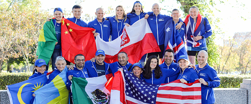 The Global Champions Team holding flags from their countries