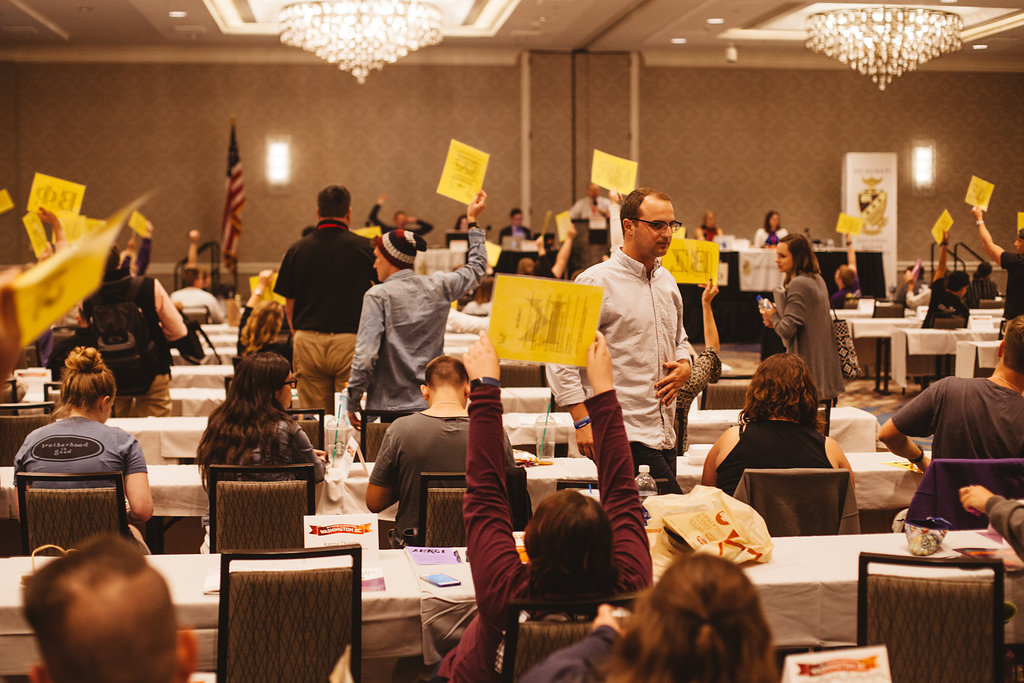 Holding up placards during Grand Chapter